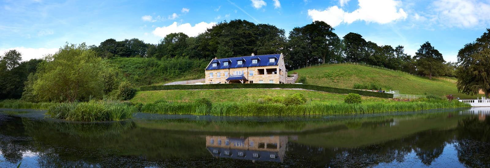 Panoramic view of the Lake House at Raithwaite Estate